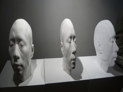 cool paper sculpture of heads, topographic, Chinese contemporary art, distorted heads