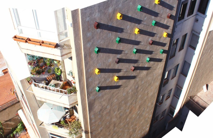 Bird Houses on side of building in Barcelona, Dom Architects, Sparrows come back to nest