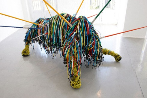 French contemporary sculpture made up of sports equipment such as bungee cords, Calydon,