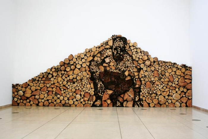 Installation using logs with silouhette of a crouching man, cool installation, Contemporary Hungarian Art, Gyula Varnai