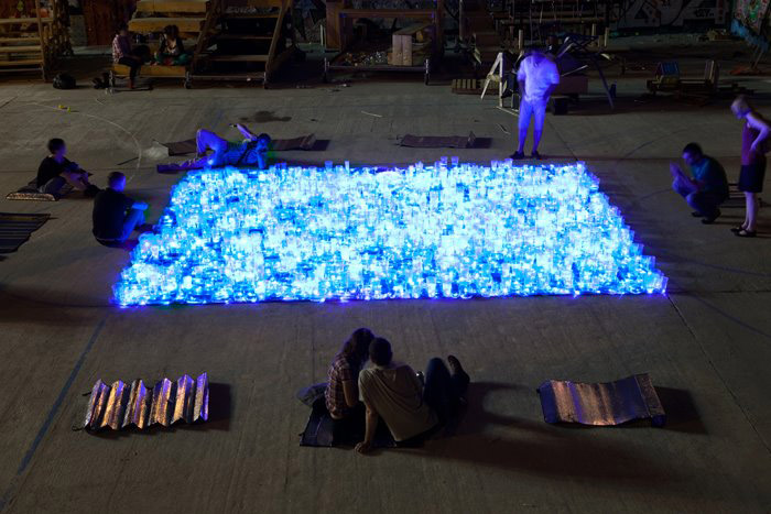 Protest and celebration of pool in Madrid, light installation, luzinterruptus, guerilla art collective, street art