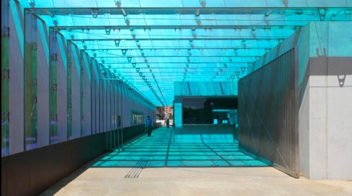 Cool subway/metro station in Spain, colored glass, nicely designed machines and seats, contemporary architecture in Spain, Luis Ferrer