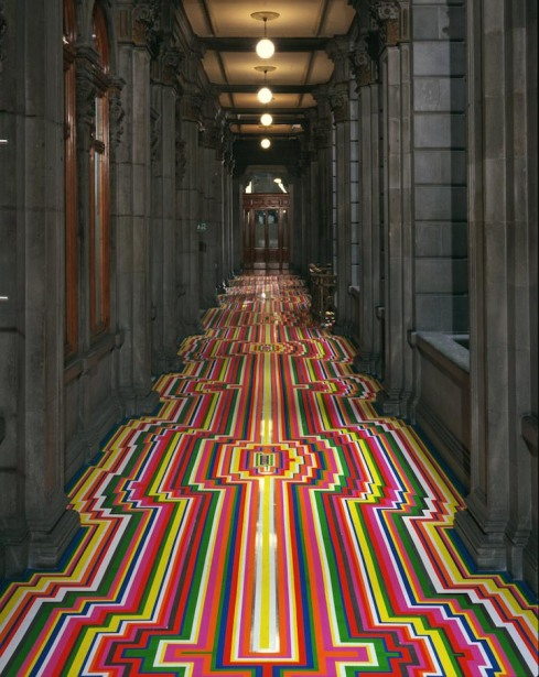 Jim Lambie, artist that uses colored tape on different surfaces to create patterns, floors, walls, stairs, art