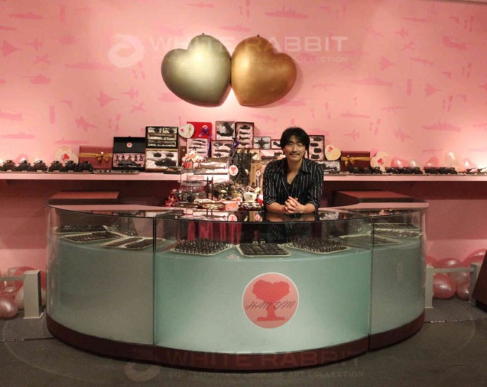 Contemporary Chinese art, Art installation with chocolate arms, grenades, guns, tiny tanks, set up as a chocolate shop