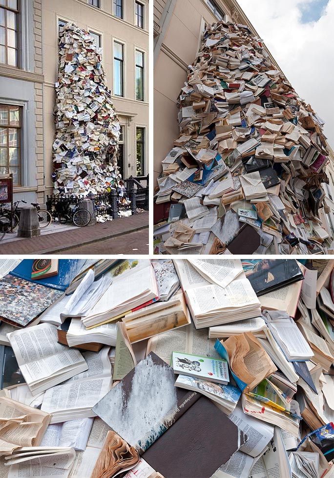 Book sculpture of thousands of books pouring out Museum Meermanno window, Alicia Martin