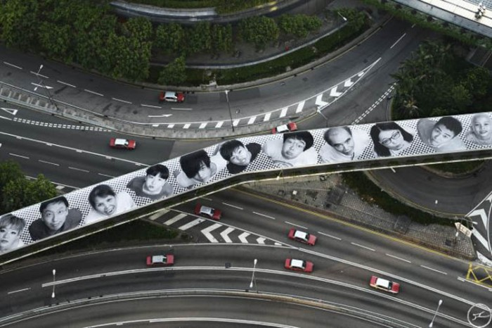 JR, inside out project, photo portrait street art in Hong Kong, Connaught Street Footbridge