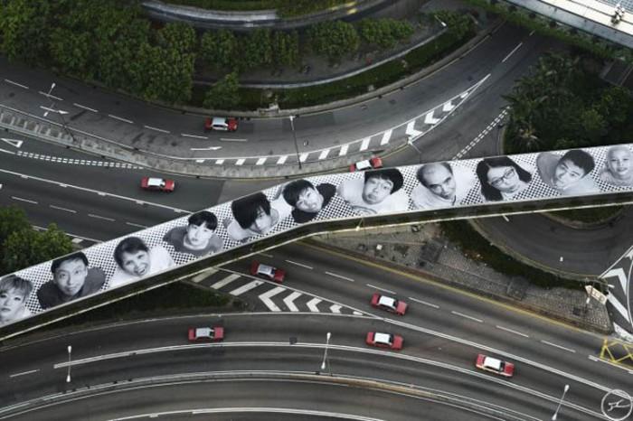 JR, inside out project, photo portrait street art in Hong Kong, Connaught Street Footbridge