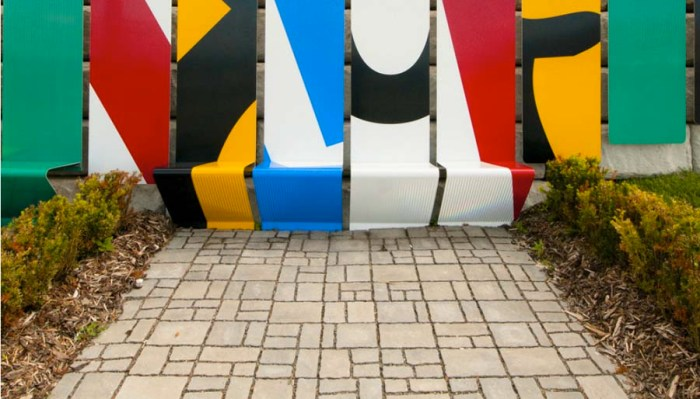 Bus Terminal installation made of colorful cropped transit symbols along a concrete wall in New Brunswick, Canada, The Acre Collective