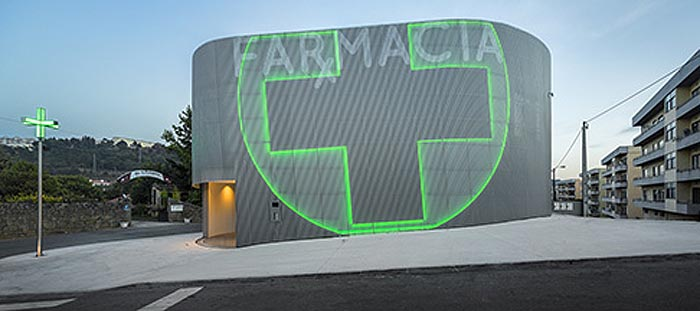 very cool pharmacy in portugal with neon sign incorporated into facade farmacia lordelo in vila. Black Bedroom Furniture Sets. Home Design Ideas