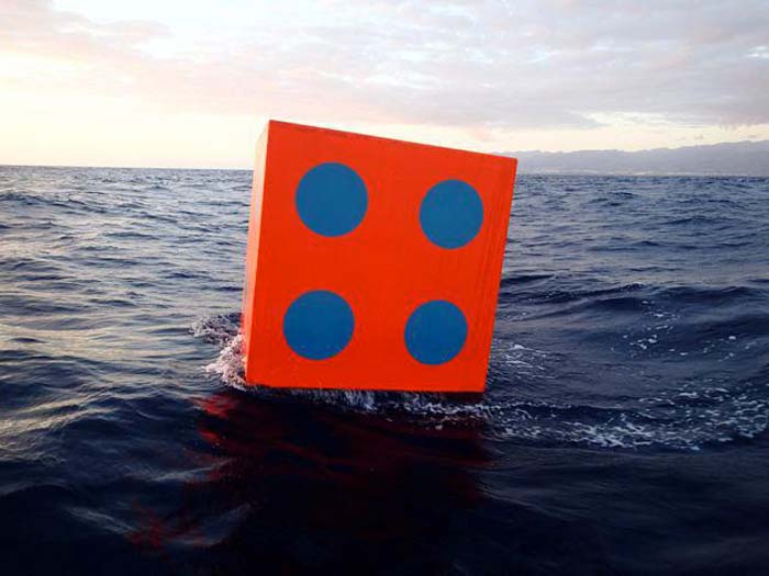 Aqua Dice by Max Mulhern, giant dice launched into the ocean, floating craps game, moving art installation, cool art intervention