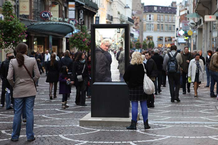 Video street installation in France by artist Thierry Fournier titled A+. Video of same street 24 hours earlier tricking viewers