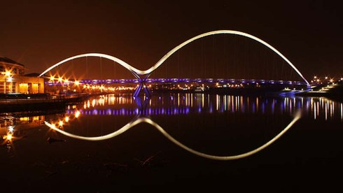 Infinity Bridge in Stockton-on-Tees, UK designed by Expedition Engineering and interactive lighting by Speirs and Majors.