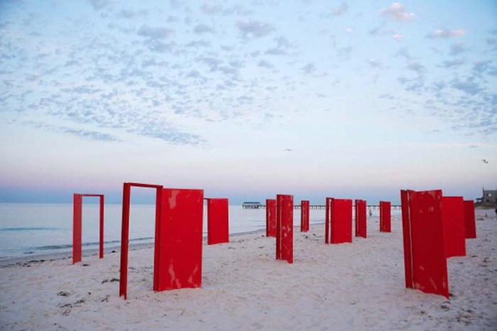 ADELAIDE, SA - DECEMBER 13:  Red doors stand on the beach before being used in an installation by surrealist artist, Andrew Baines at Henley Beach on December 13, 2012 in Adelaide, Australia. The installation was called 'Doorways To Potential'.  (Photo by Morne De Klerk/Getty Images)