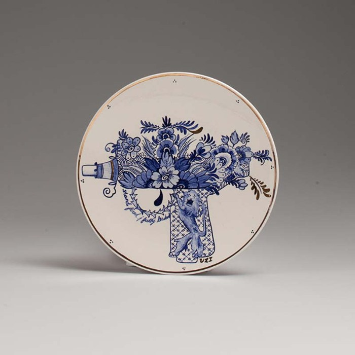 TrevorJackson, aka Agitdelft, artillery plates, floral gun and bomb plates in the style of blue willow plates, gun control