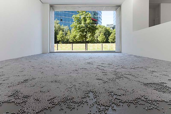robert Barta, installation art, crossing half a million stars, half a million metal balls on floor of gallery to walk over carefully