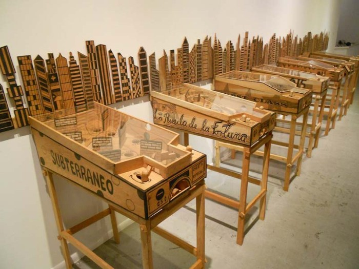 Abel Barroso, Contemporary Cuban Art, Satirical wooden sculptures with themes of social borders and immigration, pinball machines