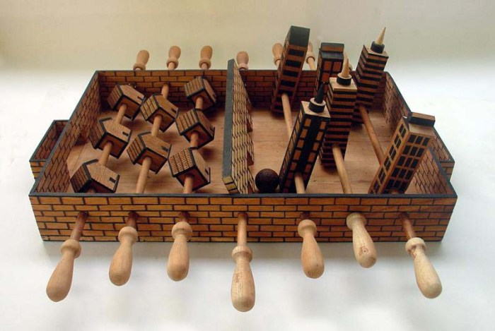 Abel Barroso, Contemporary Cuban Art, Satirical wooden sculptures with themes of social borders and immigration