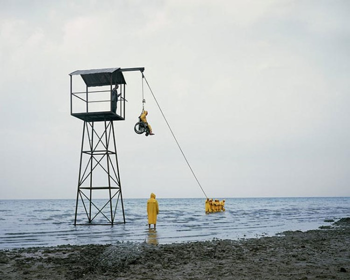 Oded Hirsch, 50 Blue, Video and Stills, wheelchair lifted by pulley to see view, contemporary Israeli art