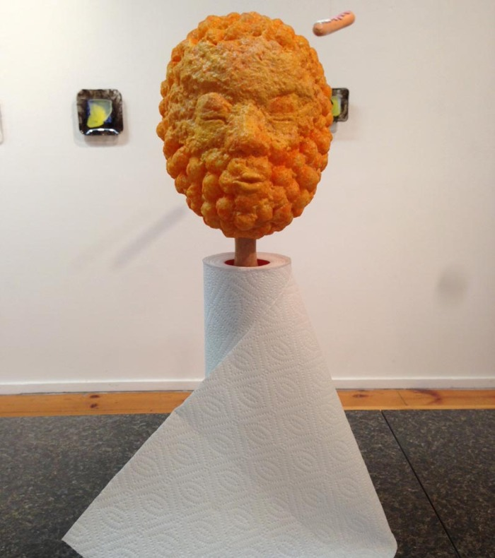 Rune Olsen, Will to Power exhibit at La Mama Gallery, NYC. Cheese-Ball Head Paper Towel Holder, Humorous Sculpture