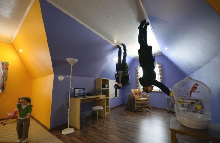 upside down house at the VVTs All-Russia Exhibition Center in Moscow. Visitors walk through and see themselves upside down.