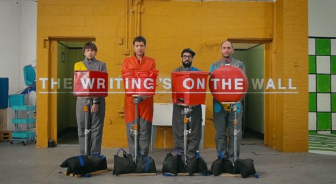 OK Go's video for The Writing's on the Wall with anamorphic effects, cool sets, cool video